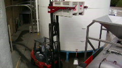 A forklift delivers crushed grapes to a bladder press for Stock Footage