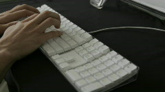 Hands type rapidly on a white keyboard. Stock Footage