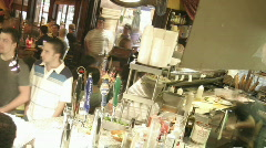 A panning shot across a busy bar in time lapse. Stock Footage