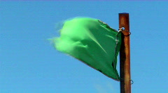 A green flag blows in the wind. Stock Footage