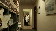Medical personnel walk through a hallway. Stock Footage