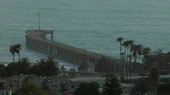 A pier curves out into the ocean. - stock footage