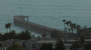 A pier curves out into the ocean. Stock Footage