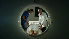 A doctor prepares a patient for a CAT scan. Stock Footage