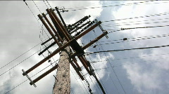 Wires run to a power pole from four directions. Stock Footage