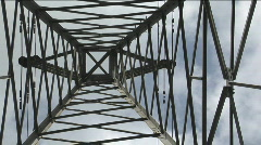 A utility tower climbs into the sky. Stock Footage