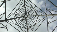 Wires stretch to either side of a utility tower. - stock footage