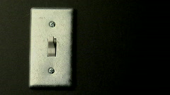 """A light switch sits in the on position."""""""" Stock Footage"""