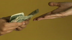 A woman pays a person with a stack of dollar bills. - stock footage