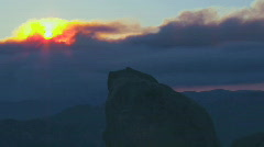 The sun peeks out from behind the clouds. Stock Footage