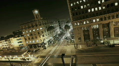 Traffic drives through a busy intersection at night. Stock Footage