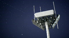 A magnificent shot of a transmitter against the moving night sky. Stock Footage