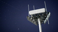 Stock Video Footage of A magnificent shot of a transmitter against the moving night sky.