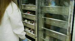 A nurse removes a bag of blood from a drawer at a blood bank. Stock Footage