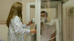 A nurse encloses a patient in a medical machine. Stock Footage