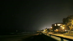 Fireworks explode off a beach in time lapse. Stock Footage