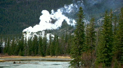 Air Pollution Smokestack Belches Industrial Waste in Forest by River Wilderness Stock Footage