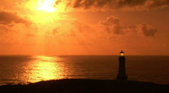 Yaquina Head Lighthouse at Sunset Along the Coast in Oregon Stock Footage