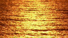 Pacific Ocean Reflects Orange Sun Light at Sunset - Background - stock footage