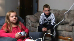 Two Kids Play Video Game Stock Footage