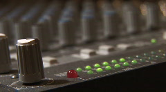 Sound Mixer Adjusts Volume with Dial - Rack Focus Stock Footage