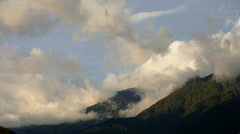 Clouds moving over forested peaks in the Andes  Stock Footage