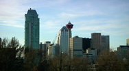 Stock Video Footage of Calgary Tower in big City skyline against big blue Sky