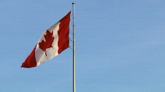 Canada Flag in Windy Blue Sky Left Justified (moving background) Stock Footage