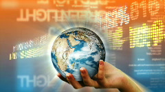 Human hand holding the Earth against stock market background Stock Footage