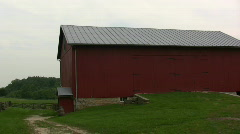 Pan of Farm Barn with Windmill Stock Footage