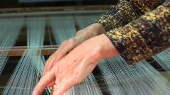 A woman works on a loom in a factory in Vietnam. Stock Footage