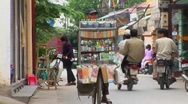 Stock Video Footage of A man pedals a bicycle loaded with medicine and other goods