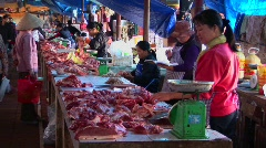 Food sellers offer their wares in a Vietnamese meat market. Stock Footage