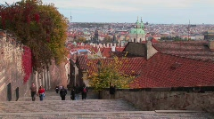 People walk on the cobblestone streets of Prague, Czech Republic. Stock Footage