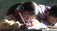 Stock Video Footage of Children practice writing in a rural classroom in China.