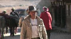 A Chinese cowboy walks through a rural village. Stock Footage