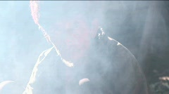 An old Chinese man looks through a cloud of smoke. Stock Footage