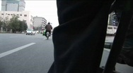 Stock Video Footage of A POV shot of a man pedaling a rickshaw through the streets