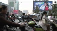 Stock Video Footage of Large amounts of traffic pass by on a Beijing China street
