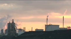 A time lapse shot from day to night of a petrochemical Stock Footage
