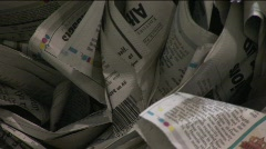 Old crinkled newspapers sit in a recycling bin in a factory. Stock Footage