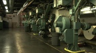 Stock Video Footage of Workers watch paper rollers in newspaper factory.