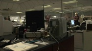 A point of view shot walking through a newsroom. Stock Footage