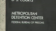 A zoom back from a Federal Detention Center in Los Angeles. - stock footage