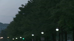 Pan across from a tree lined boulevard to the Capitol - stock footage