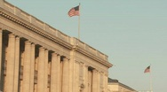 Flags fly atop buildings in Washington DC. Stock Footage