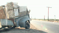 An abandoned trailer sits along an empty highway. Stock Footage