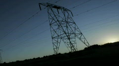 High tension lines against the rising sun. Stock Footage