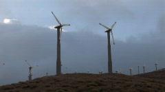 Windmills generate power on a hillside in california. Stock Footage