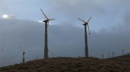 Windmills generate power on a hillside in california. Stock Footage